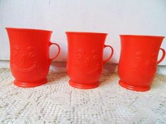 Retro Red KOOL AID Plastic Mugs - Cups with Smiling Face Etched on the Front   via Orphaned Treasures Etsy