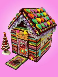 A delightful combination of gingerbread and candy colors create this whimsical shoppe that looks good enough to eat! It's a great starting place to begin creating your own enchanted village.