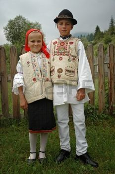 art hungarian: GHIMES, ROMANIA - .JUNE 3: Children in traditional clothes participate at festivities during a wedding. Folklore and traditions are well kept in Hungarian communities around Transylvania. June 3, 2005 in Ghimes, Romania Editorial