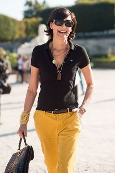 Inès de La Fressange. Parisian Timeless. Basic black polo top with coloured skinnies...everyday classic.