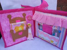 Dollhouse quiet book opens up to show eight different play areas for the little fabric doll to explore.  Page prices start at $18 for a book like this. A completed book costs $144 plus postage and can be customized with names on beads, hand written letters in the dollhouse mail box and even tiny photos inserted into the book. https://www.facebook.com/sparklesandstring