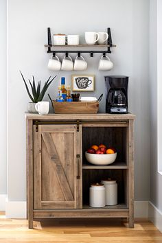 coffee bar ideas Looking to add a touch of rustic inspired style to your home? This accent storage cabinet from the Better Homes and Garden's Modern Farmhouse collecti Coffee Bars In Kitchen, Coffee Bar Home, Home Coffee Stations, Coffee Bar Ideas, Diy Coffe Bar, Office Coffee Station, Wine And Coffee Bar, Coffee Station Kitchen, Diy Bar