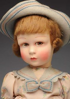 """Description:Lovely French Venus Doll.  All cloth with molded face, artistically painted features with very dramatic eyes, mohair wig; all original child's outfit with hat. Original 'VENUS ETsD Paris Made in France"""" label. Beautiful example!  Condition (Excellent). Size 16"""" T.    Estimate: 500.00 - 750.00"""