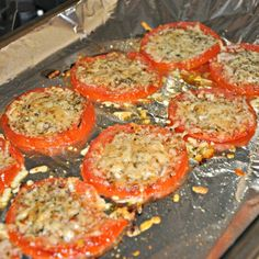 Baked parmesean roasted tomatoes..delish on their own and amazing on a hamburger! 1/2 inch slices, salt and pepper, shredded parm. mist top with cooking spray and Bake @ 425 - 20 minutes until tender and cheese is lightly browned.