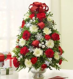 Flower Christmas tree. Cool idea. I would like mine with pink and white flowers