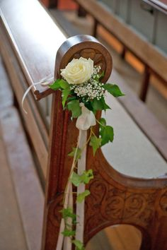 put flowers on the end of each pew to symbolize those who have passed on, their favorite flower