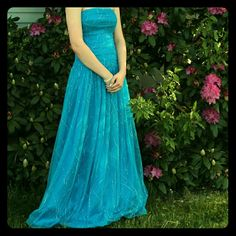 "Strapless Sparkly Peacock Blue Prom Dress Beautiful ""Reign On"" lace up prom dress with beautiful sparkle design.  Strapless Lace up back No alterations No stains Great condition! Reign On Dresses Strapless"