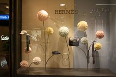 Hermes shuttlecocks windows by Lekker Design, Singapore window display  Hermes boutique at Takashimaya – Ngee Ann City.