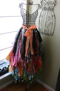 """SCARV ORGANIZER Fun idea for ribbon storage, but easily modified to hair ribbon/ponytail storage as well I""""m thinking,especially the smaller form on the wall behind."""