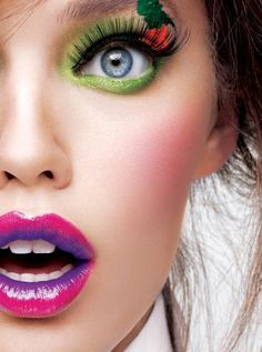 I don't like the red/green splash above the eye, but for some reason I love everything else. Amazing lips and eyeshadow!