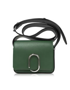 Alix Flap Mini Crossbody crafted in bi-color smooth leather, is the perfect petite messenger that adds a striking touch to your day to evening style. Featuring flap top with signature Alix paperclip clasp, adjustable wide flat crossbody strap, exterior back slip pocket. internal card slots and silver tone hardware detail. Signature dust bag included.