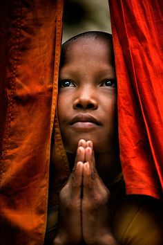 Young Christian child in difficult Life situations ___ saying prayers in her heart, believing she has been heard.