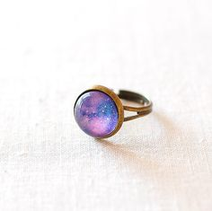 Purple Galaxy Ring. Space Ring. Glass Dome Ring. Adjustable Ring. Universe Jewelry. by JujuTreasures on Etsy https://www.etsy.com/listing/123625369/purple-galaxy-ring-space-ring-glass-dome
