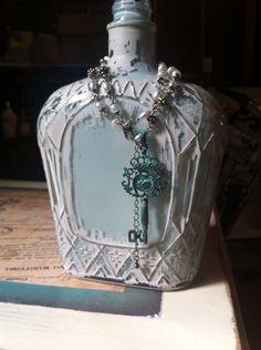 Vintage painted crown royal bottle.