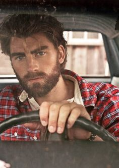 I wouldnt mind a Rugged Mountain Man like bear grills himself :] or like this dude ^^ that's hot.