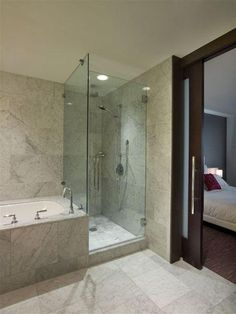 Modern Bathroom with marble tile encased jacuzzi tub