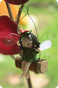 This cute little fairy is having fun on her swing, she will be lovely anywhere in your home or maybe in your Christmas tree!    approx. 12 cm *