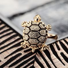 http://www.storenvy.com/products/1215381-gold-plated-sea-turtle-ring
