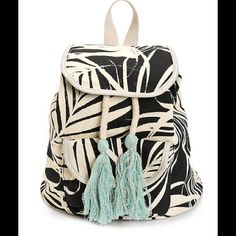 """HPPalm Print Canvas Backpack This compact size backpack is perfect for your next vacay. It is made with a black and white palm print canvas exterior that is accented by a thick adjustable draw cord and mint tassel detailing. Features a cinch closure, with magnetic snap for secure storage. Snap pouch pocket for additional storage. Adjustable shoulder straps. Top handle for easy carry. Measures 10"""" high x 10"""" wide x 5"""" deep. Bags Backpacks"""