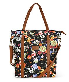 Carry all your personal items in style with the Boddington tote made with a floral print canvas exterior accented with brown leather trims, handles and removable crossbody strap.