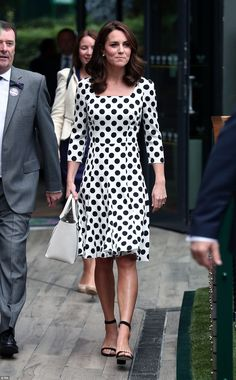 The Duchess arrived at the SW19 grounds this morning in a polka dot dress by Dolce & Gabba...
