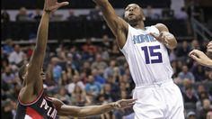 #NBA Charlotte Hornets' Kemba Walker (15) shoots over Portland Trail Blazers' Damian Lillard (0) during the first half of an NBA basketball game in Charlotte, N.C., Wednesday, Jan. 18, 2017. (AP Photo/Chuck Burton)