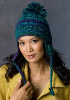 Comfy Earflap Hat in Red Heart Boutique Unforgettable - LW2846. Discover more Patterns by Red Heart Yarns at LoveKnitting. The world's largest range of knitting supplies - we stock patterns, yarn, needles and books from all of your favorite brands.