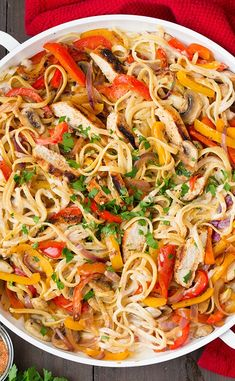 closeup of Cajun Chicken Pasta garnished with basil and tossed in creamy cajun pasta sauce