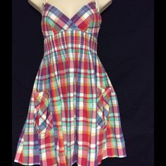 Ralph Lauren/RUGBY Sundress  NWOT Size 0 This beautiful sundress is by the Ralph Lauren Rugby  collection  it is NWOT.I bought it for a special event but ended up not going..The color of the plaid is very bright & colorful. The shoulders are rope,two front pockets & a zipper on the side. It has a cinched waist & flare out to give you that hourglass figure.It is a size 0,How ever I'm usually a size 4 & it fits me perfectly. I would suggest to buy only if you have a smaller chest. Cute dress…