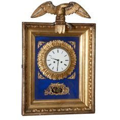 Gilded wood wall mounted Empire clock
