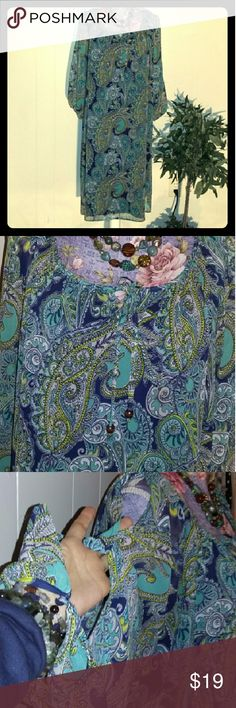 Cato Woman Cold Shoulder Paisley Shift Dress EUC Very unique dress by Cato woman size 22-24W. The dress is made of 100% polyester.  The liner is also made of polyester. The neckline has a keyhole with a tie. One small bead at the end of the ties. There is also a triangle cut out on the nape of the neck and the back. The sleeves are the cold shoulder style but they also have cutouts down the bottom part of the sleeve with a single button on the cuff. Very unique and very pretty. Excellent…