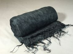 This beautiful, authentic Yak wool blanket was hand-loomed in Kathmandu, Nepal. It is a dark iron gray with black throughout. These blankets are