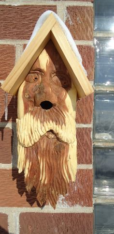 Hand carved cedar wood birdhouse face, complete with a solid cedar house, looks great in any outdoor setting.