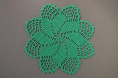 New hand-crocheted doily. This beautiful, lacy doily would be an elegant centerpiece, a lovely accent for your home. Color: green. Please note that colors shown may vary depending on your monitor settings. Material: 100% mercerized cotton. Size approximately: 7 in (18 cm). Please, dont hesitate to email me if you have any questions.