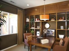 Warm Home Office: This richly toned office has a view of the courtyard. From HGTVRemodels.com