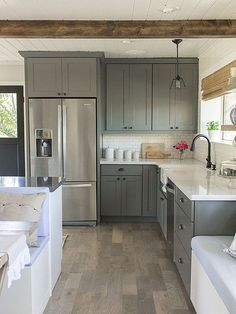 DIY Kitchen Remodeling | I love this kitchen with gray cabinets and crisp white counters and tile.