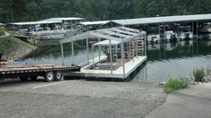 DockScapes installed a nice CAT 3 dock at Tim's Ford earlier this week. This dock features a standard  single-slip with a wide-side. The main deck consists of Aluminum Sandstone decking, and is lined with custom Wahoo bumpers. A  gable roof painted Patrician Bronze offers protection from the skies. Overall a very nice dock!