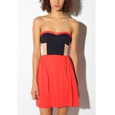 Urban Outfitters Strapless Dress I've been really obsessed with the colorblocking trend -- and I plan to ride it as long as I can into fall. This pretty little Urban Outfitters dress will definitely help with that. I love the placement of the colored side panels; they create such a pretty, slimming look. And the bodice is incredibly flattering. Urban Outfitters Dresses Strapless