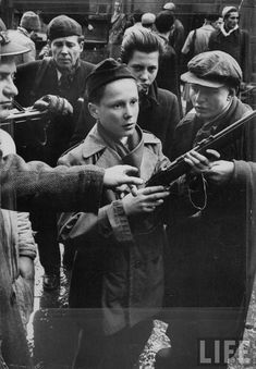 Hungarian Revolution of 1956. Budapest boys from about twelve to late teens…
