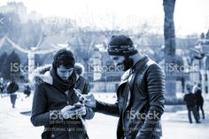 Two Young Men Are Looking Smartphones royalty-free stock photo