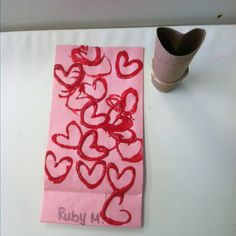 Use toilet paper roll to decorate Valentines Day bags