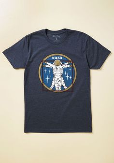 Vitruvian Man On the Moon Men's T-Shirt | Mod Retro Vintage Mens SS Shirts | ModCloth.com  There's no end to the amount of inspiration you'll offer your fave guy when you present him with this blue T-shirt! Featuring a red, white, and gold graphic of an artful astronaut inspired by a real NASA mission patch, this top invites your dude - or you - to stylishly reach for the stars.