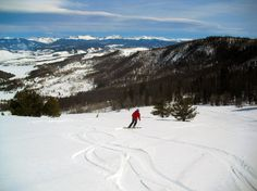 Snow Cat Skiing The C Lazy U dude ranch hands will take you up into the hills on a Snow Cat so you can ski down to your heart's content.