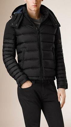Burberry Black Down-Filled Technical Puffer Jacket - A showerproof puffer jacket filled with insulating down. Featuring a detachable hood, the jacket is constructed with a contrast panel over the shoulders and check cotton lining. Discover the men's outerwear collection at Burberry.com