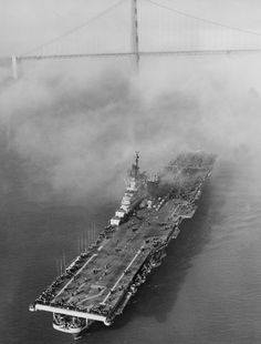 The aircraft carrier U.S.S. Boxer creeps through the fog under the Golden Gate Bridge in San Francisco as it arrives from Korean waters, Sept. 25, 1952. It was the Boxer from which the Navy launched drone aircraft for an attack on Communist concentrations in Korea. Aboard the ship were more than 2,500 men of Air group two. She will later go to Hunter's Point, a South San Francisco Naval Base for complete overhaul. (AP Photo)