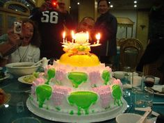 """This came up an a search for """"bizarre"""" wedding cakes, but maybe it's a grotesque birthday cake-look at the topper. Or else it's just a bad photo taken in front of a blazing fire in the fireplace? KV"""