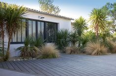 Photo gallery of exteriors by Jean-Florian Leroy architect of the Patio Tropical, Tiny House Exterior, Landscape Design Plans, Rustic Home Design, Pergola Attached To House, Garden Structures, House Front, Backyard Landscaping, Landscaping Ideas