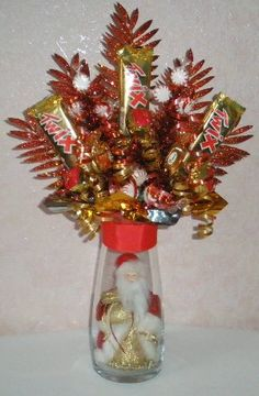 homemade candy christmas decortions | Step 9. Insert candy flowers in the arrangement spacing them evenly ...
