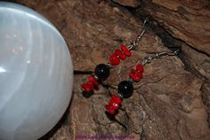 Obsidian and Red Bamboo Coral french hook earrings by Catinas, $12.50