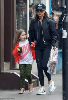 The new Sporty Spice? Victoria Beckham put on a casual display as she took her only daughter Harper for a walk through West London on Friday